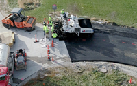 Road crew paving the driveway using the bioasphalt.