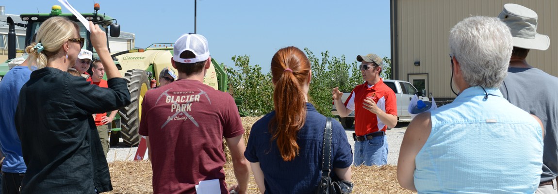 A researcher giving a tour of the BioCentury Research Farm.