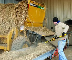 A researcher taking apart a bale.