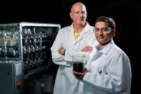 Robert C. Brown and Santanu Bakshi, left to right, are part of a team looking for ways to make biochar -- a black powder that's a co-product of bio-oil production -- more useful and valuable. Larger photo. Photos by Christopher Gannon.